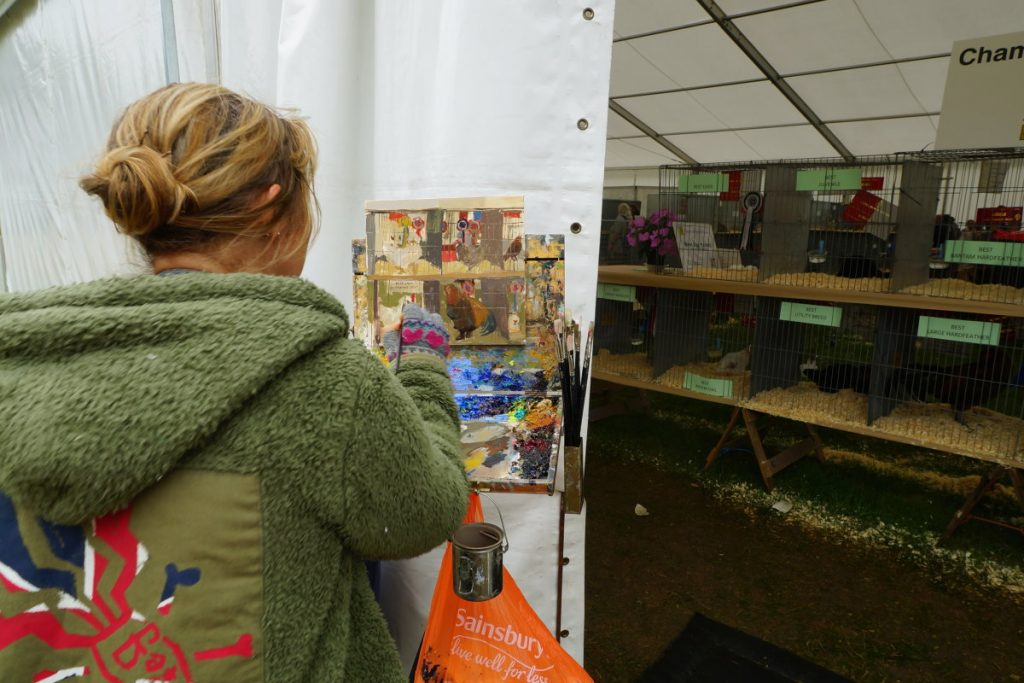 Haidee-Jo Summers painting Chickens at RNS17. Photo by Katy Jon Went