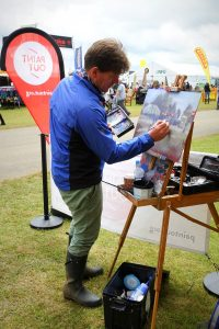 Tom Cringle painting Norfolk Showground at RNS17. Photo by KJW