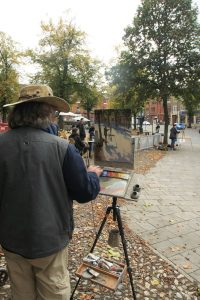 Michael Richardson painting an artist painting Tombland public paint out. Photo © Katy Jon Went