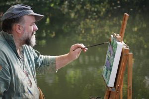 Artist John Behm painting like a modern Monet on the River Wensum, Paint Out Norwich 2017. Photo © Katy Jon Went