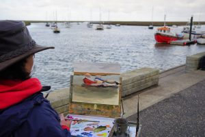 Artist Karen Adams painting Wells Quayside. Photo by Katy Jon Went
