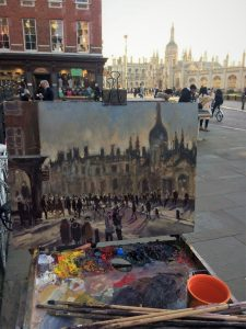 Artist Sarah Allbrook painting plein air, February sunshine on King's Parade, Cambridge