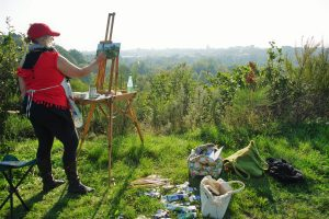 Artist Mary Blue Brady painting on Mousehold Heath, Paint Out Norwich 2017