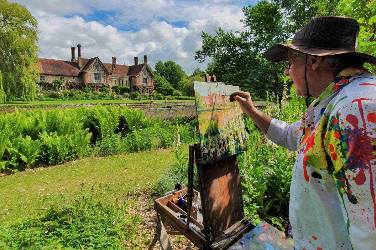 Artist Stephen Johnston painting plein air at Paint Out Elsing Hall Gardens, Norfolk