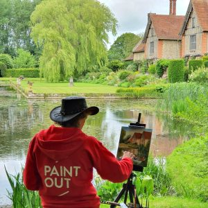 Artist Eleanor Alison painting plein air at Paint Out Elsing Hall Gardens, Norfolk