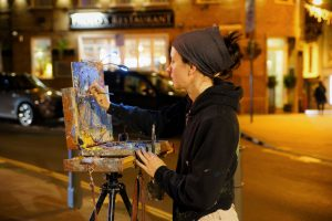 Artist Emily Faludy painting a nocturne during Paint Out Norwich