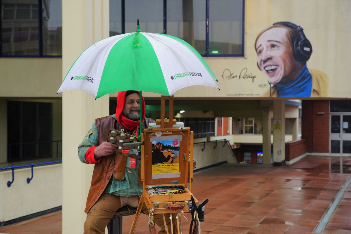 Artist John Behm painting Anglia Square outside Hollywood Cinema, Paint Out Norwich