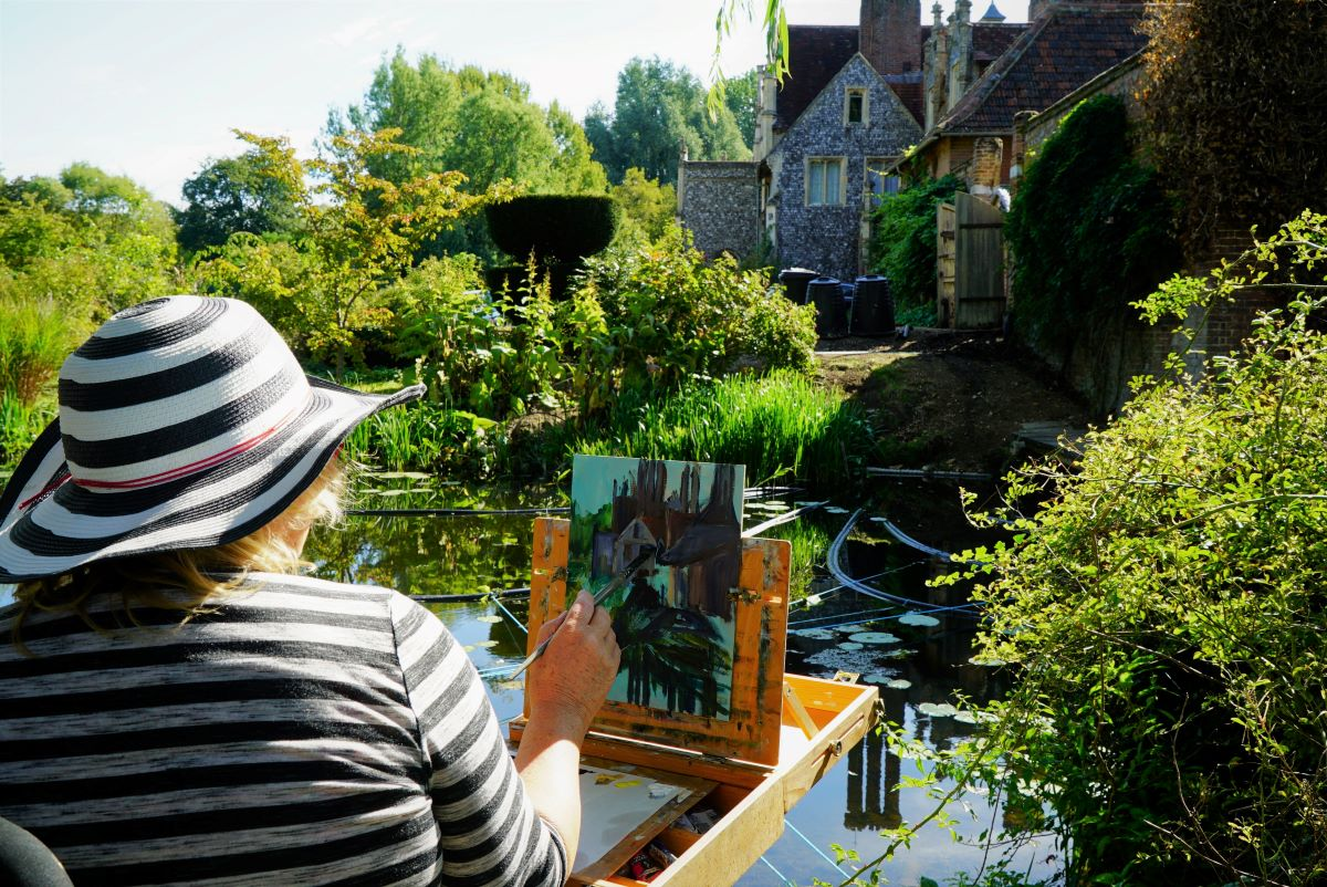 Artist Amanda Barrett painting at Elsing Hall, Norfolk, during Paint Out Gardens 2019