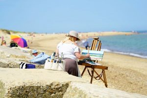 Artist Mary Blue Brady painting Winterton Beach during Paint Out Norfolk 2020. Photo © Katy Jon Went