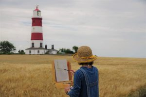 Naomi Clements-Wright painting Happisburgh Lighthouse during Paint Out Norfolk 2020