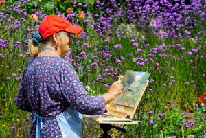 Artist Kate Gabriel painting Winterton allotments, Paint Out Norfolk 2020