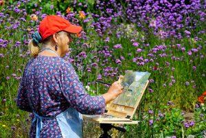 Artist Kate Gabriel painting Winterton allotments, Paint Out Norfolk 2020